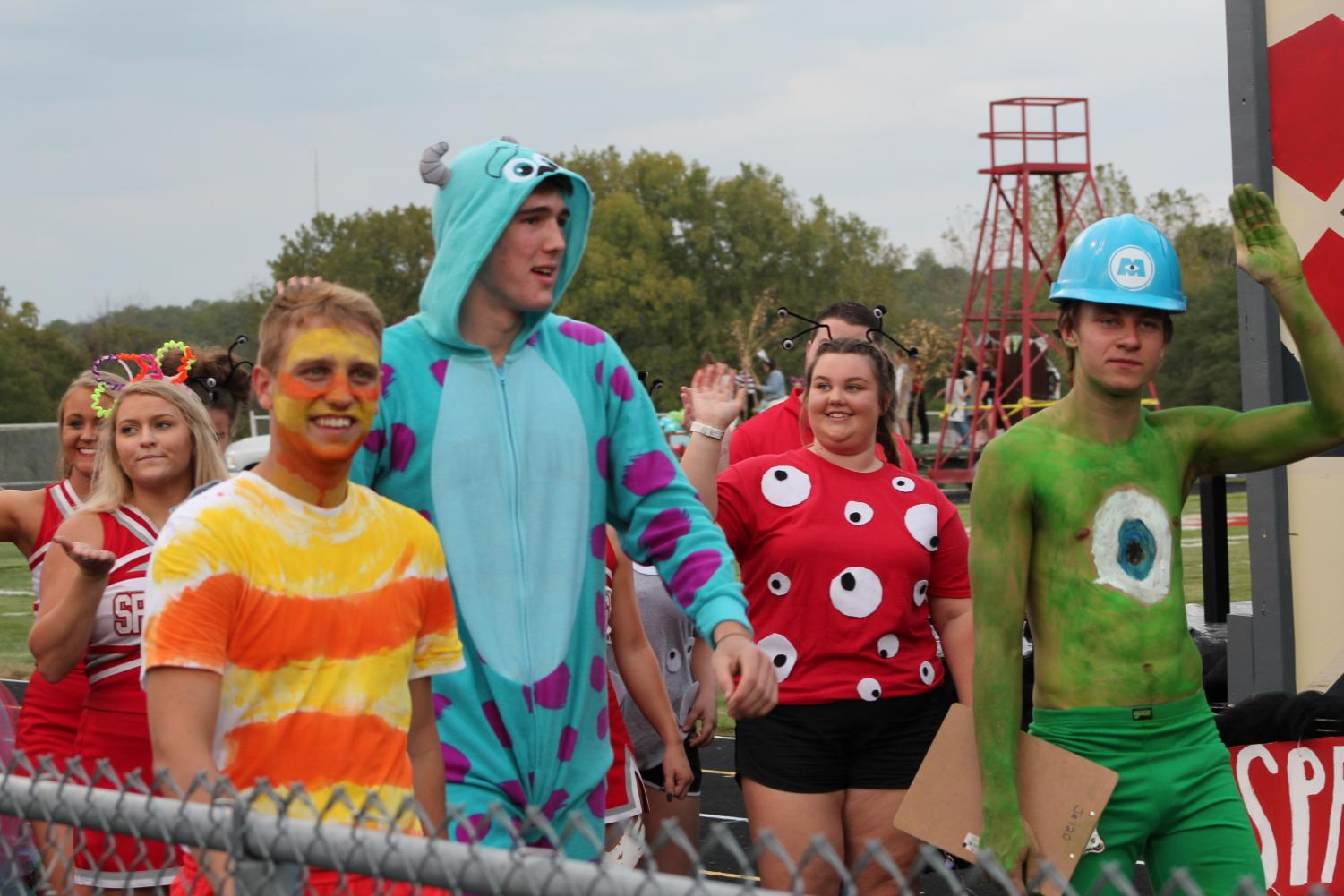 Seniors walk with their Monsters Inc float